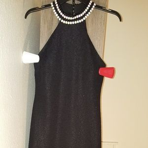 Black dress fits a size 5/6